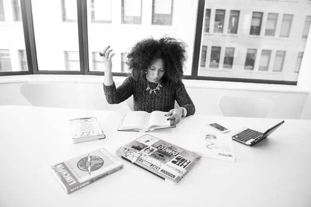 adult black woman working at her desk