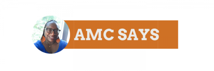amc smiling in front of a window